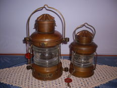 Two old copper ship's lamps. ANKER