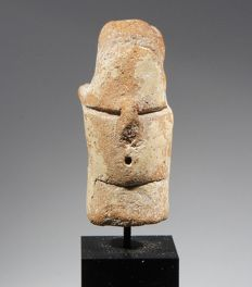 A rare Greek, Neolithic mask attached to a columnar head. Terracotta h 4 cm