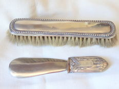 A silver clothes brush, together with a matching shoehorn, the latter with Art deco style silver handle - Portugal - circa 1910