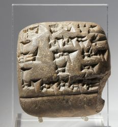 An Old Babylonian cuneiform tablet with translation. Size: 46 x 46 mm