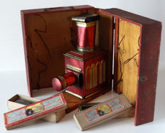 magic lantern made of polychrome tin circa 1880 In its original box // 2 boxes of plates