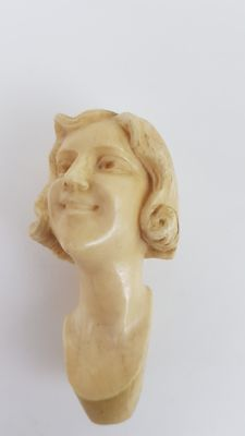 An Ivory sculpture of young ladies head