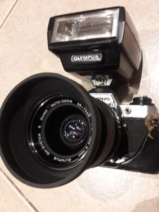 Olympus OM10 body + Olympus 35-70mm auto zoom + Electronic flash T32