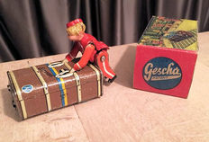 Gescha, Germany - Length 9 cm - Tin / Masse Express Piccolo suitcase boy with clockwork motor, 1930s