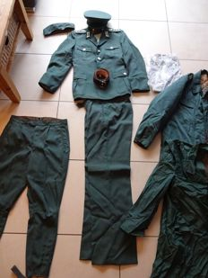 Complete GDR NVA Police Uniform - Hat, Cap, Summer + Winter Jacket, Raincoat, 2 Pairs of Trousers, Belt, Shirt