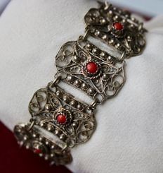 ca. 1900/40 beautiful handcrafted filigree silver bracelet, eight finely perforated rectangles with natural Blood coral cabochons.