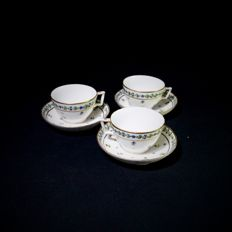 Three cups and saucers with blueberry