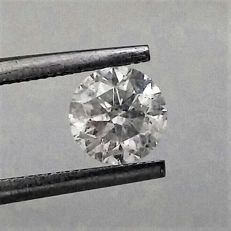 Round Brilliant Cut  - 1.01 carat - E color - SI2 clarity- Comes With AIG Certificate + Laser Inscription On Girdle
