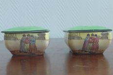 Two antique storage containers from the Royal Doulton series 'Green Dutch Haarlem Series'