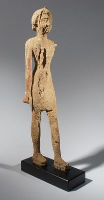 Egyptian statue of a walking servant, wood H. 19,5 cm