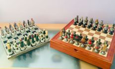 Lot of chess sets, the Chessmen 2005 and Kanzi Romans against Arabs.