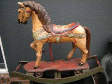 Wooden rocking horse - polychrome painted - on wheels and with swing mechanism