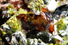 Honey brown Titanite, Clinozoite and dark green Epidote crystals on Orthoclase matrix - 8.3 X 5.1 X 4.8 cm - 61 gm