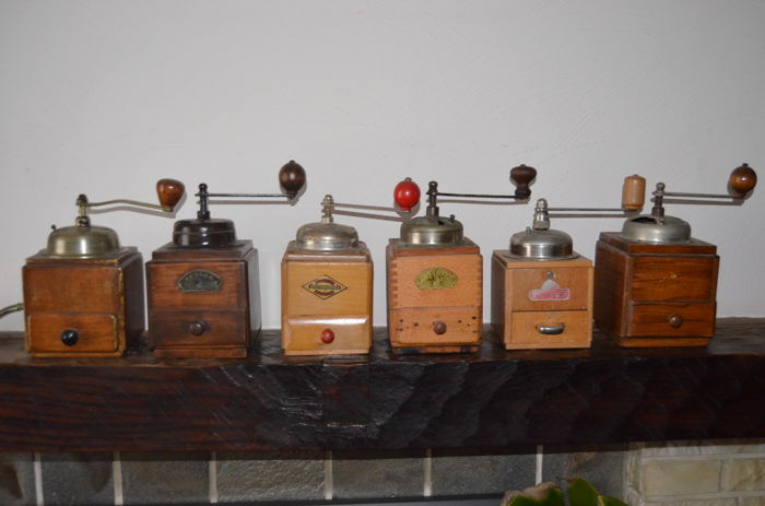 Six wooden coffee grinders, mid 20th century