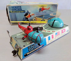 "Biller, Western Germany - C. 22.5cm - ""Tin wind-up Remote Control Helicopter"", 1950s"