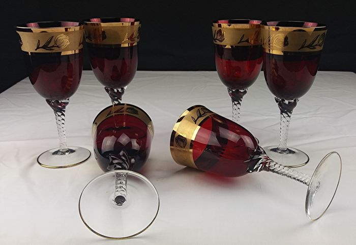 Set of ruby red crystal stem glasses for white wine