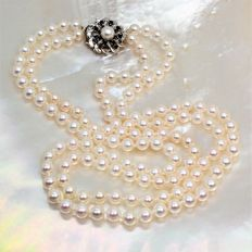 Beautiful two rows necklace saltwater pearls Ø5x6mm - WG18K clasp with Sapphires