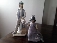 2 Nao Lladro Stauettes - Young Man and Young Girl