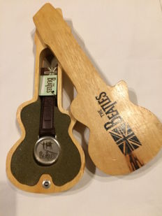 Beatles memorabilia, collectible watches with guitar watch cases