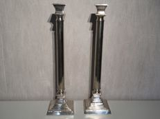 Two large silver-plated candlesticks