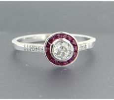 Pt entourage ring in Art Deco style, set with ruby and Bolshevik cut and octagon cut diamonds, approx. 0.65 carat in total, ring size: 17.25 (54)****NO RESERVE PRICE******