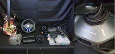 Playstation 1 + 2 Controllers + Guitar Hero + Driving Wheel and Pedals + Singstar Microphones + 5 Games + Force3D Pro Joystick
