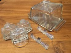 Art Deco pressed glass cheese cover, salt-pepper-mustard set and two knife rests