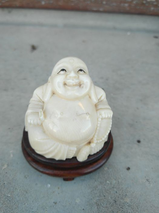 Laughing Buddha statue in ivory on a finely sculpted wooden pedestal - China - circa 1930