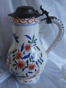 A Delft earthenware/faience pitcher with a tin lid
