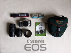 Canon EOS 300 with two lenses and a professional camera bag