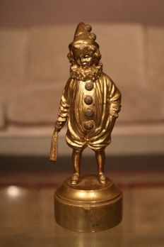 A solid bronze sculpture of a Pierrot