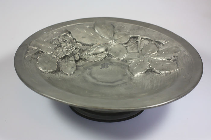 Pewter dish with music box