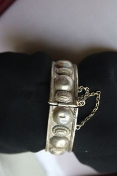 Circa 1890/1900 handcrafted silver bracelet with engraved antique elements, antique lock with safety chain.