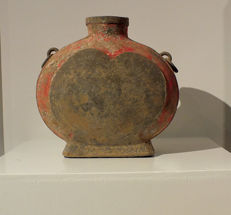 A Grey Pottery Wine Vessel, Bianhu,  H. 24,5 cm.