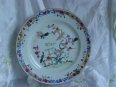 A porcelain, Famille Rose, deep plate - China - 18th century.