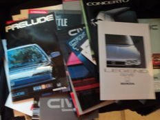 52 original Honda brochures and 30 slides and 2 complete product overview brochures