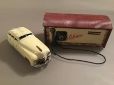 "Schuco, US Zone Germany - Length maximum 16 cm - Tin Garage ""Magico 500"" and Patent Car 1750 with clockwork motor, 1950s"