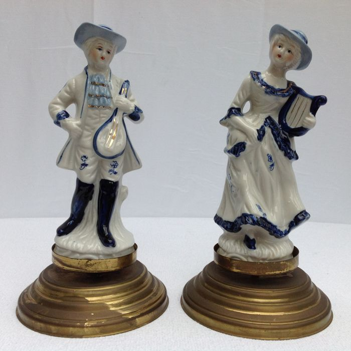 Two music boxes, man and woman