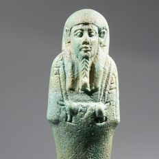 Superb turquoise faience ushabti of the charioteer Nes-Iah.  H 15