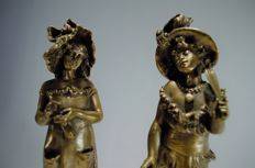 Lalouette (1826-1883) - A pair of silvered bronze figures on marble plinths