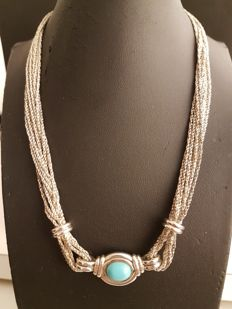 925 silver necklace with central cabochon cut turquoise.