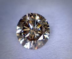 0.52 ct brilliant cut diamond, intense brown, SI1.