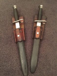 Original Swiss bayonets with original leather holders for on the belt