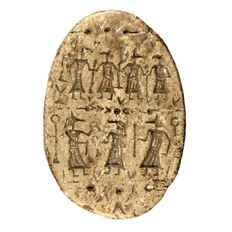 Scarab Seven Anubis in long garments Steatite length = 10.6 cm