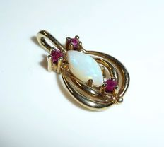 Pendant 8 kt. / 333 gold with natural, Australian, full opal of 0.40 ct + 3 rubies