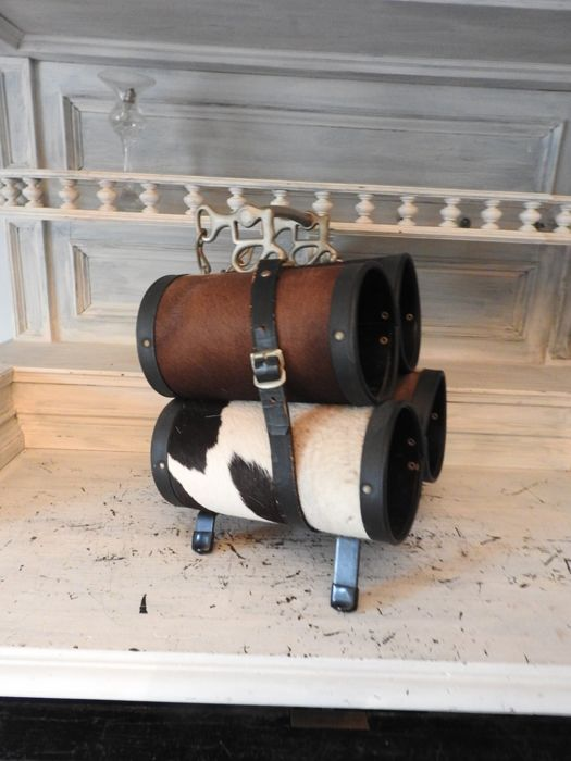 Retro wine rack in a cow hide with a horse bit - vintage 1960s
