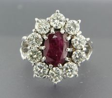 14 kt white gold entourage ring set with centrally an oval cut ruby surrounded by 10 brilliant cut diamonds of approx. 3.40 ct in total