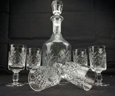 Saint Louis, set of 7 pieces in engraved, cut crystal