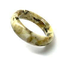 Wide cut bangle bracelet of  marble patterned Baltic Amber, weight 45.7 grams