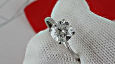 1.07 ct  round diamond ring made of 14 kt white gold - size 6